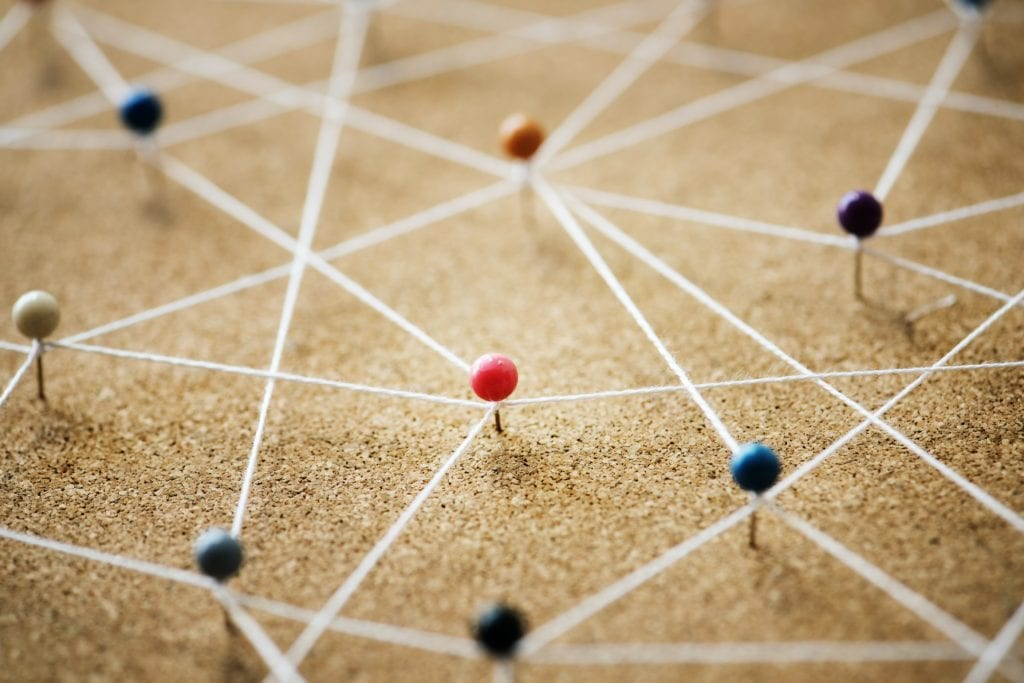 a network of pins and string